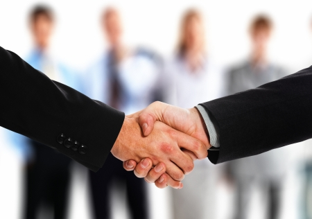 Close-up of two businessmen shaking hands photo
