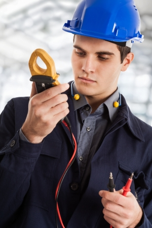Portrait of an electrician using a tester photo