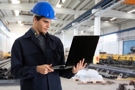 Portrait of an engineer using a laptop computer photo