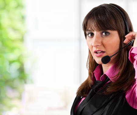 Portrait of a beautiful customer representative at work Stock Photo - 17792284