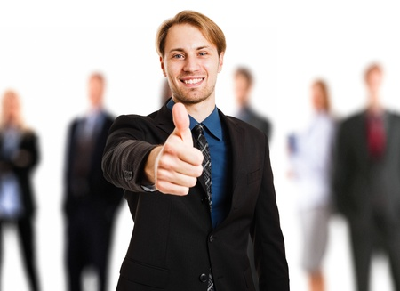 Businessman doing thumbs up sign photo
