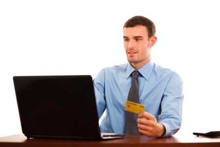 Portrait of a man using a credit card for online shopping Stock Photo - 17791962