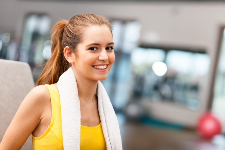 fitness club: Young woman smiling in a fitness club