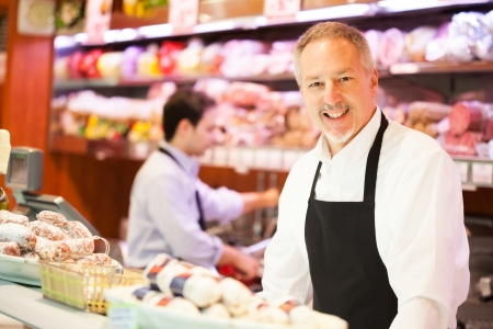 sales clerk: Shopkeepers at work in a grocery store Stock Photo