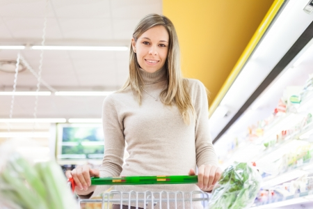 Woman shopping at the supermarket Stock Photo - 17791958