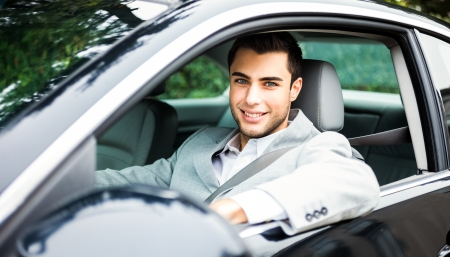 insurance services: Portrait of a man driving a car Stock Photo