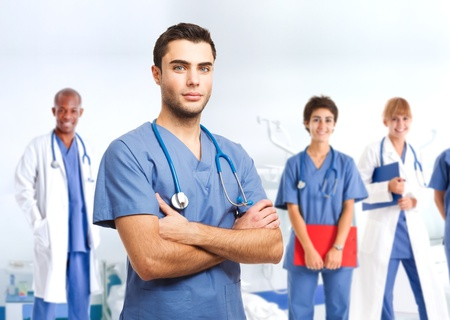 practitioner: Portrait of an handsome doctor in front of his medical team Stock Photo