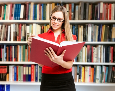 Bookcase: Portrait of a woman reading a book Stock Photo