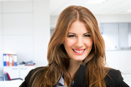 Portrait of a smiling young woman Stock Photo - 18466272