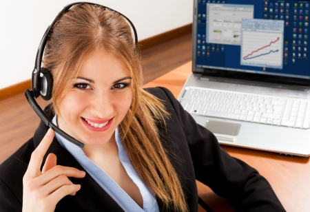 Portrait of a beautiful smiling businesswoman at work Stock Photo - 18466221