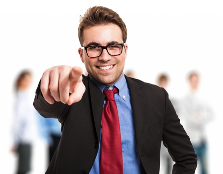 Friendly businessman pointing his finger at you photo