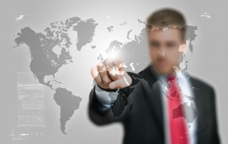 visions of america: Businessman pointing his finger on a hi-tech world map