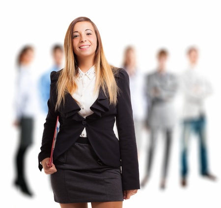 Portrait of a young businesswoman in front of her team photo