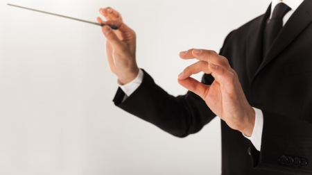conductor: Leader directing an orchestra