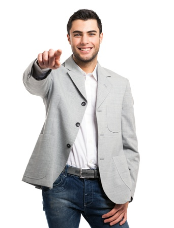 Handsome man pointing his finger to you  Isolated on white photo