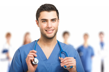 general practitioner: Portrait of an handsome doctor in front of his medical team Stock Photo