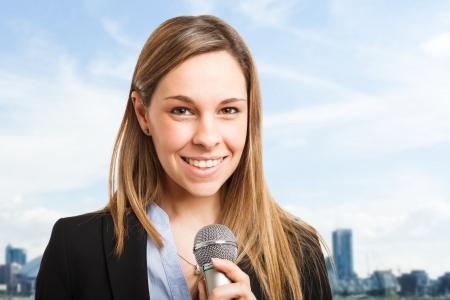 Woman talking on the microphone photo