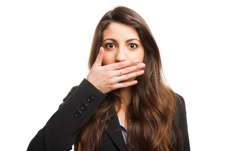 secret: Woman shutting her mouth Stock Photo
