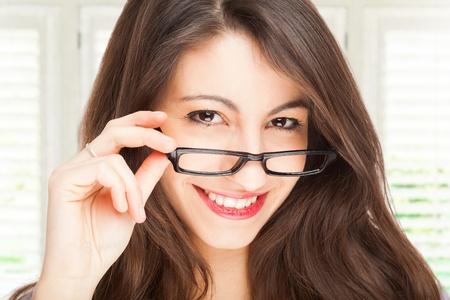 Portrait of a smiling beautiful woman wearing eyeglasses photo