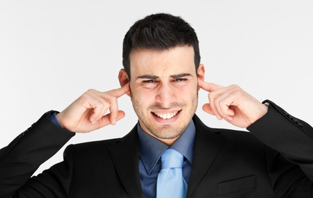 indifferent: Businessman turning a deaf ear