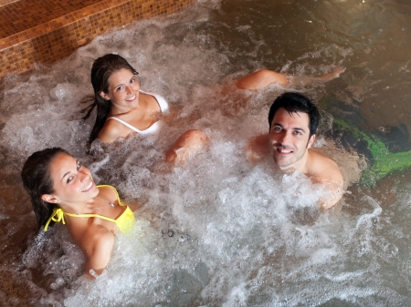 male massage: Group of people relaxing in a spa