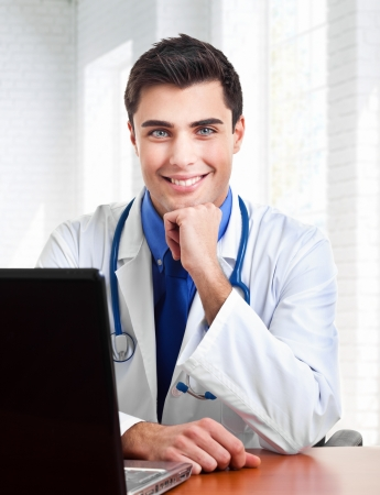Portrait of an handsome young doctor Stock Photo - 19094356