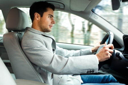 upkeep: Portrait of a man driving his car Stock Photo