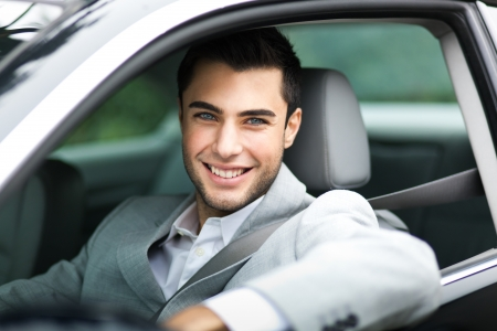car service: Portrait of a man driving his car Stock Photo