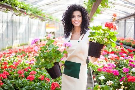 Beautiful woman holding flower pots Stock Photo - 19360251