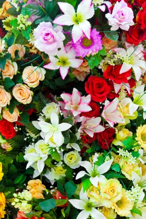 flower seller: Composition of artificial flowers in a greenhouse Stock Photo