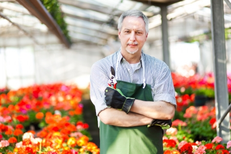 floriculture: Portrait of a smiling greenhouse worker