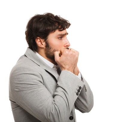 apprehension: Funny portrait of a scared young man Stock Photo