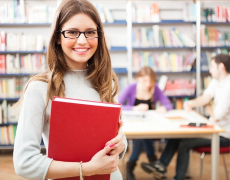 educational research: Portrait of a woman reading a book Stock Photo