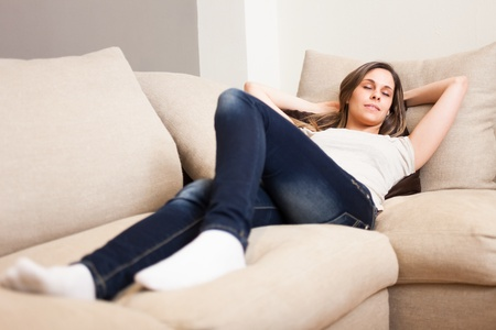 Portrait of a young woman sleeping on the couch Stock Photo - 19567988