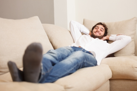 Young man relaxing on his couch photo