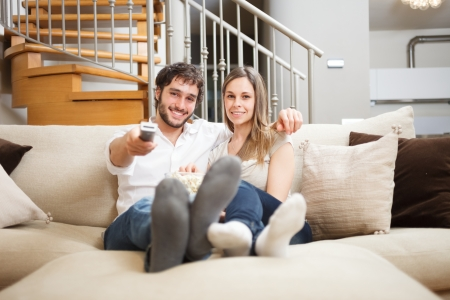 Young couple preparing to watch a movie photo
