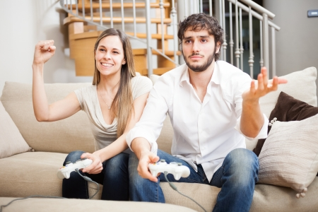 Young couple playing video games in their apartment photo