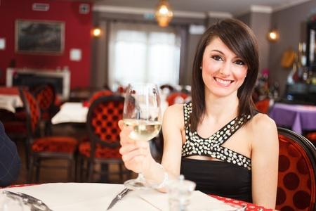Woman having dinner in a restaurant photo