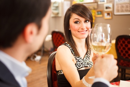 romantic date: Beautiful couple toasting wineglasses in a restaurant