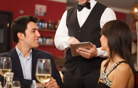 Couple ordering dinner in a restaurant photo