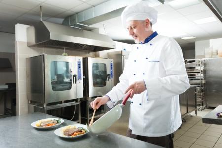 Chef preparing a dish in his kitchen photo