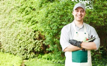 bush trimming: Portrait of a professional gardener