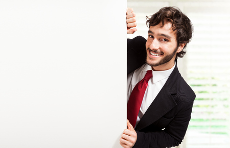 Handsome man showing a blank board Stock Photo - 22207455