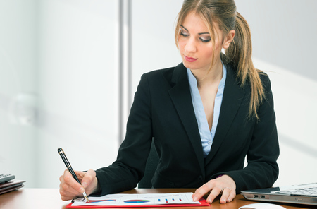 Beautiful woman working in her office Stock Photo