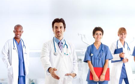Handsome doctor offering an handshake photo