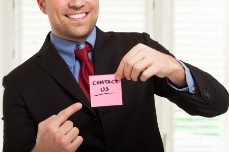 Businessman showing a Contact Stock Photo - 22207767