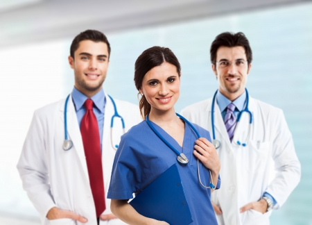 medical student: Portrait of a smiling nurse in front of her medical team Stock Photo