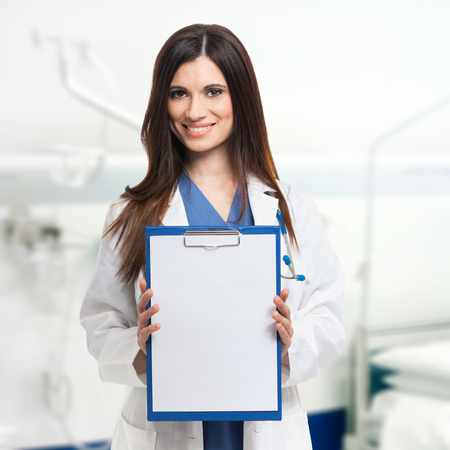 Female doctor showing a sheet of white paper Stock Photo - 22207891