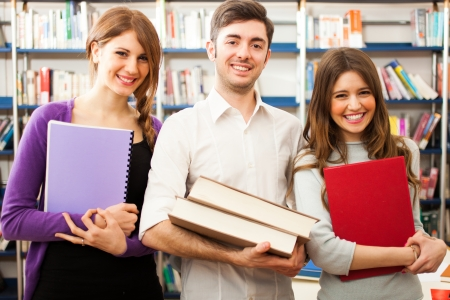 Group of people at work in a library Stock Photo - 22208107