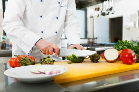 Chef preparing vegetables in his kitchen Stock Photo - 22208284